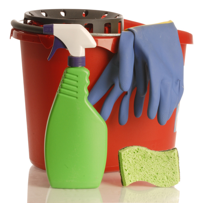 household cleaner with rubber gloves bucket and sponge